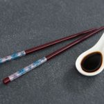 Soy Sauce in Spoon next to chop sticks